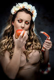 Woman with red apple and snake Stock Photos