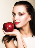 Woman with red apple Royalty Free Stock Photo