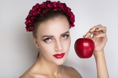 Woman red apple stock photos