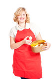 Woman with red apron and cookie box Royalty Free Stock Image