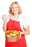 Woman with red apron and cookie box Stock Images