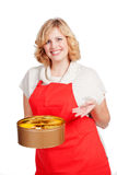Woman with red apron and cookie box Royalty Free Stock Photos