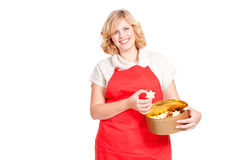 Woman with red apron and cookie box Stock Image