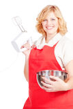 Woman with red apron and mixer Stock Photo