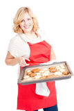 Woman with red apron present christmas cookies Royalty Free Stock Photos