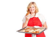 Woman with red apron present christmas cookies Stock Photo