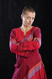 Woman in red, arms crossed Stock Images