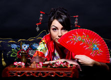 Woman in red Asian costume Stock Photography