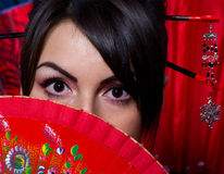 woman with red Asian fan Royalty Free Stock Photo