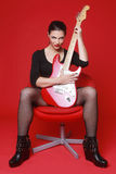 Woman on Red Background With Electric Guitar Stock Photos