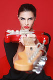 Woman on Red Background With Electric Guitar Royalty Free Stock Image