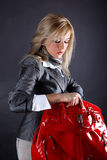 Woman with red bag Royalty Free Stock Photos