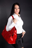 Woman with red bag Stock Photography