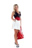 Woman with red bag isolated on white Royalty Free Stock Photo