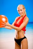 Woman with red ball Stock Photos