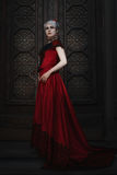 Woman in a red ball gown. Stock Photos