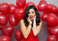 Woman with red ballons Stock Image