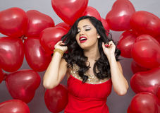 Woman with red ballons Royalty Free Stock Photography