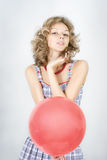 Woman  with red balloon Royalty Free Stock Photos