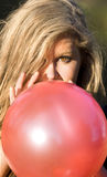 Woman with red balloon Royalty Free Stock Image