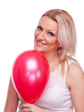 Woman with red balloon Stock Photos