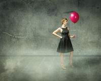 Woman with red balloon in abstract place Royalty Free Stock Photos