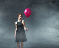Woman with red balloon on hand Royalty Free Stock Photo