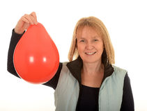 Woman with a red balloon Royalty Free Stock Image