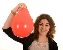 Woman with a red balloon Royalty Free Stock Photos