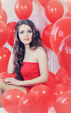 Woman with red balloons, tinted Stock Photography