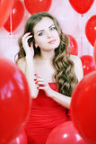 Woman and red balls Royalty Free Stock Photo