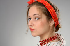 Woman with a red bandage on a head Stock Photography