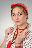 Woman with a red bandage on a head Royalty Free Stock Photography