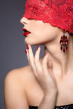 Woman with red bandage Royalty Free Stock Photography