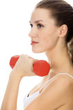 Woman with red barbell Royalty Free Stock Photo