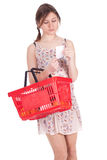 Woman with red basket checking purchases list Royalty Free Stock Photography