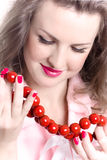 Woman with red beads Stock Images