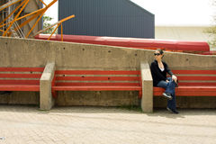 Woman on red bench Stock Photo