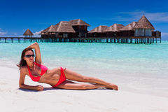Woman in red bikini in beach destination Stock Images