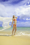 woman in red bikini and chiffon Royalty Free Stock Images