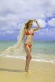 Woman in red bikini and chiffon Stock Photo