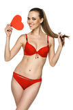Woman in red bikini showing heart shape Royalty Free Stock Images