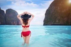 Woman in red bikini at tropical beach. Stock Image