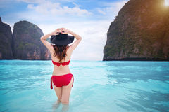 Woman in red bikini at tropical beach. Vintage tone Stock Image