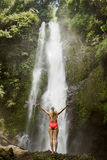 Woman in red bikini and waterfall. Stock Photography