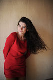 Woman in red. The woman with black long hair in the red Royalty Free Stock Photo