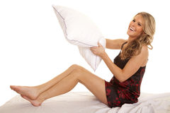 Woman red black nightgown bed pillow fun Stock Photography