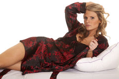 Woman red and black robe side hand hair Stock Photos