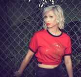 Woman in Red and Black T-shirt Standing Near Chain Fence royalty free stock photos