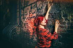 Woman in Red Black and White Plaid Holding Gray Concrete Wall Royalty Free Stock Photos